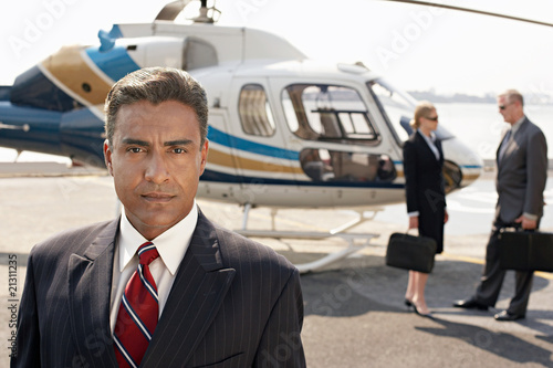 Tuinposter Helicopter businesspeople by helicopter