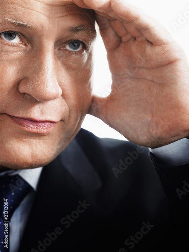 Fototapety, obrazy: business man holding hand up to face close up