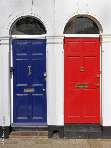 Photo Red and blue doors with white surrounds