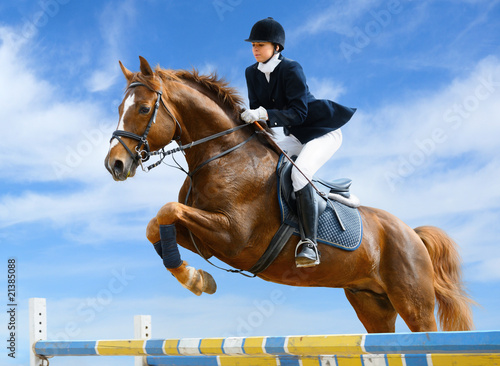 Poster Equitation Equestrian jumper - Young girl jumping with sorrel horse