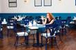 beautiful girl sitting in a restaurant