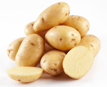 Yellow Potatoes With Sections On A White Background