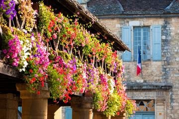 Fototapeta na wymiar Geraniums and a French flag.