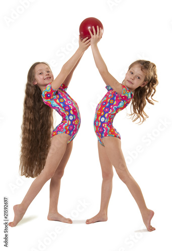 Two little girls gymnasts with the ball - Buy this stock photo and