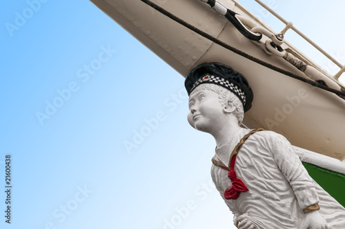 Boy figurehead on sailing ship Fotobehang