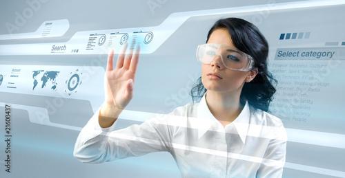 Fotografie, Obraz  Pretty young lady using new technologies