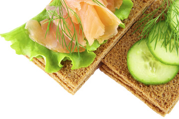 Sandwiches with salmon and  cucumber on a white background