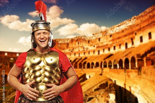 Photo  Roman legionary soldier in front of coliseum