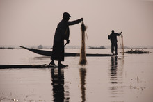 Fisherman Rows His Boat With H...
