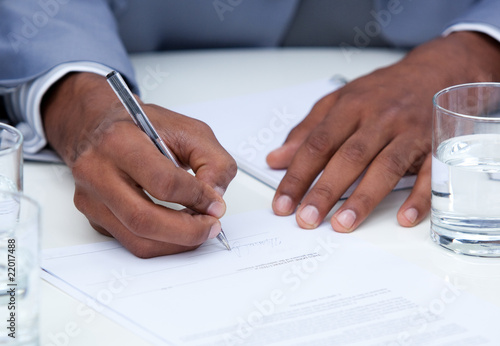 Close-up of ambitious business man signing a contract Canvas Print