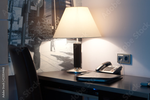 This Is A Table With Lamp And Phone On It Kaufen Sie Dieses Foto