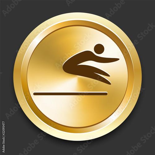 Fényképezés  Long Jump on Golden Internet Button