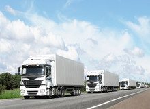Caravan Of White Trucks On Hig...