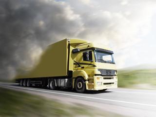 truck speeding on highway to the light