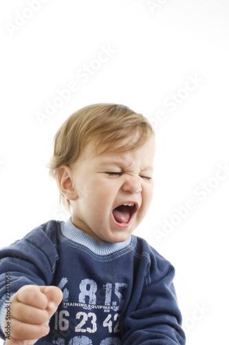 Valokuva  Portrait of angry baby boy closeup