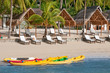 boats and canoes on a tropical beach