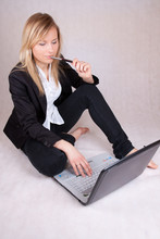Beautiful Business Woman Over Laptop With Ballpen In Mouth