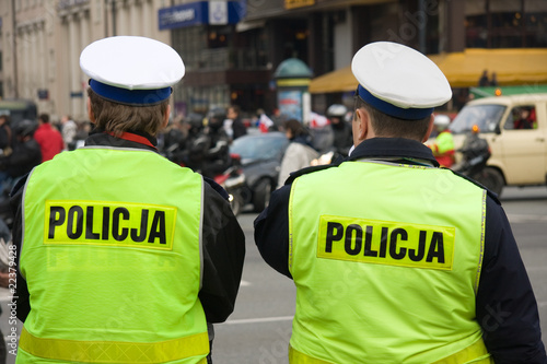 Fotografie, Obraz  Two unrecognizable polish police officers on a street