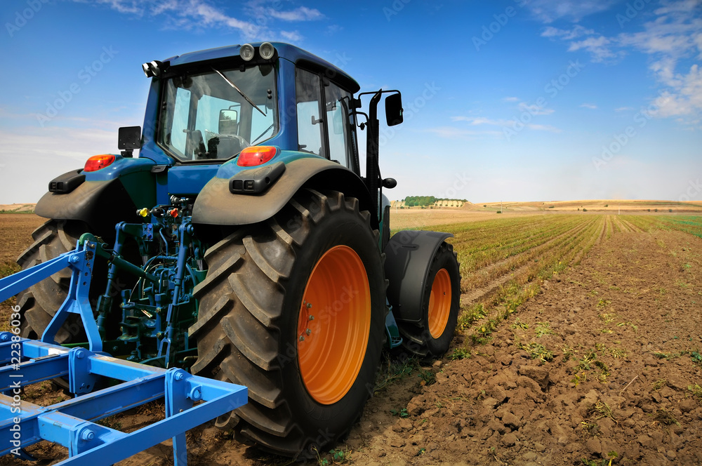 Fototapety, obrazy: The Tractor - modern farm equipment in field