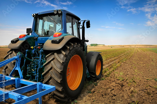 Fotografering  The Tractor - modern farm equipment in field