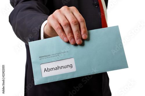 Fotografia  Mann übergibt Brief mit Abmahnung