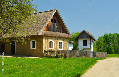 Photo  Old houses with roof from straw in wood