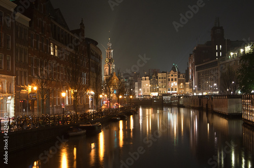 Photo  Amsterdam channel by night and Westerkerk