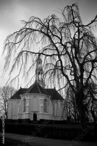 Aluminium Prints Old church with dark clouds