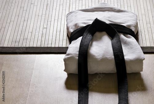 Photo  judo gi with black belt