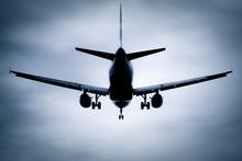 Passenger Jet Silhouette Against A Soft Blue Background