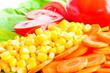 Fresh salad close-up. Corn, carrot, red tomato, green lettuce