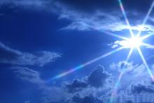 A Star Shape Sun Shining Brightly Through The Clouds