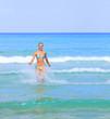 tanned woman in bikini in the sea