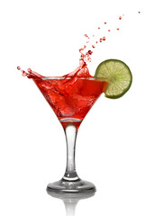 Fototapeta Red cocktail with splash and lime isolated on white