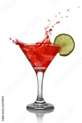 Fotografie, Obraz  Red cocktail with splash and lime isolated on white
