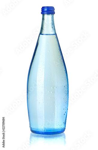Fotografia  Glass bottle of soda water