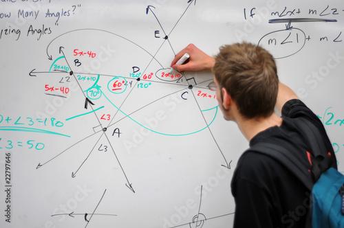 Fotografie, Obraz  Student writing math on whiteboard