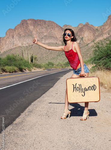 Beautiful woman hitching a ride to Hollywood Canvas Print