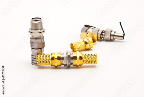 Fotografía  gilded television connectors on a white background