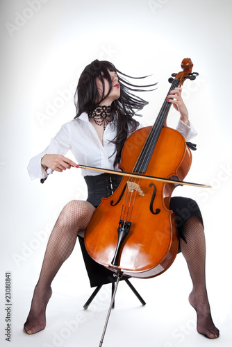 Sensual girl playing cello and moving her hair Fototapeta