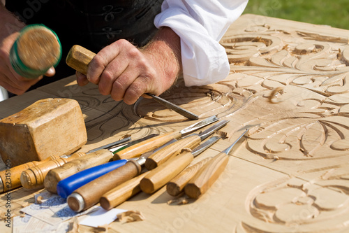 Canvas Print Traditional craftsman carving wood