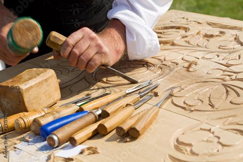 Traditional craftsman carving wood Fototapeta