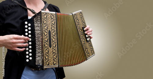 Woman playing traditional accordion Tablou Canvas