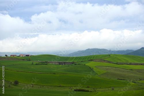 Poster Hill paesaggio con casa