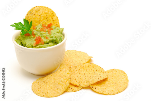 Fotografie, Obraz  guacamole and corn chips isolated