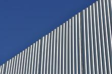 Aluminum Fence Against Blue Sky, Diagonal View