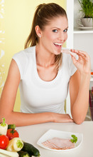 Young Beauty Woman Eating Ham And Vegetables