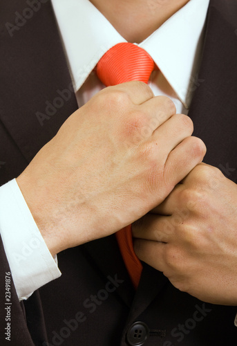 Fototapety, obrazy: Detail of young businessman correcting a tie