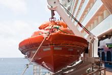 Orange LIfeboat Hanging On Cru...