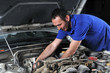 Auto mechanic working on car engine - a series of MECHANIC